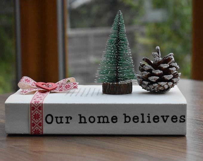 Christmas decorative book, Our home believes, Rustic festive book stack, Farmhouse Christmas decor, Christmas tiered tray decor, Shelf decor