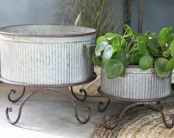 beautiful planter on foot for flowers made of zinc