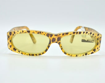 A pair of my worn white 80/'s vintage sunglasses from Ugly Shyla .