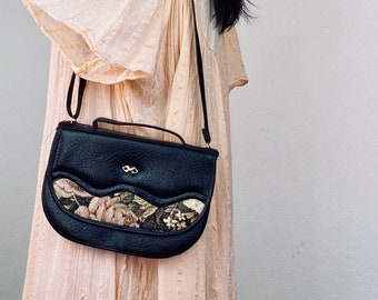 1990s black leather tapestry bag.