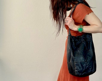 1980s black soft leather patchwork bucket bag.