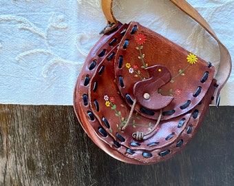 1970s tooled hand painted leather bag.