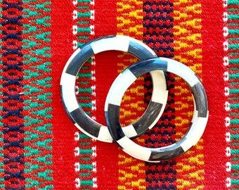 1970s set of two striped horn bracelets.