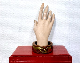 1970s solid wood bangle with brass ornaments.