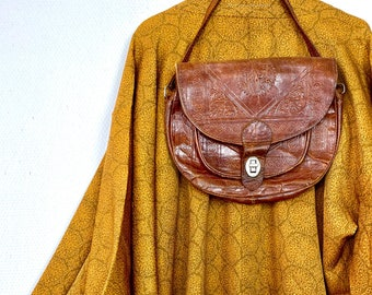 1970s Moroccan tooled leather bag.