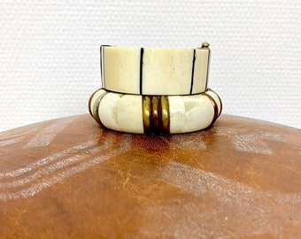 1970s set of two horn and wood bracelets.