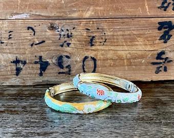 1980s set of two enamel bracelets.