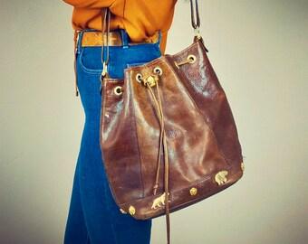 1990s brown leather drawstring bucket bag.