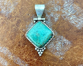 1970s turquoise & silver pendant.