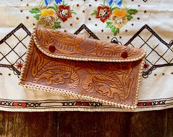 1970s handmade large tooled leather clutch.