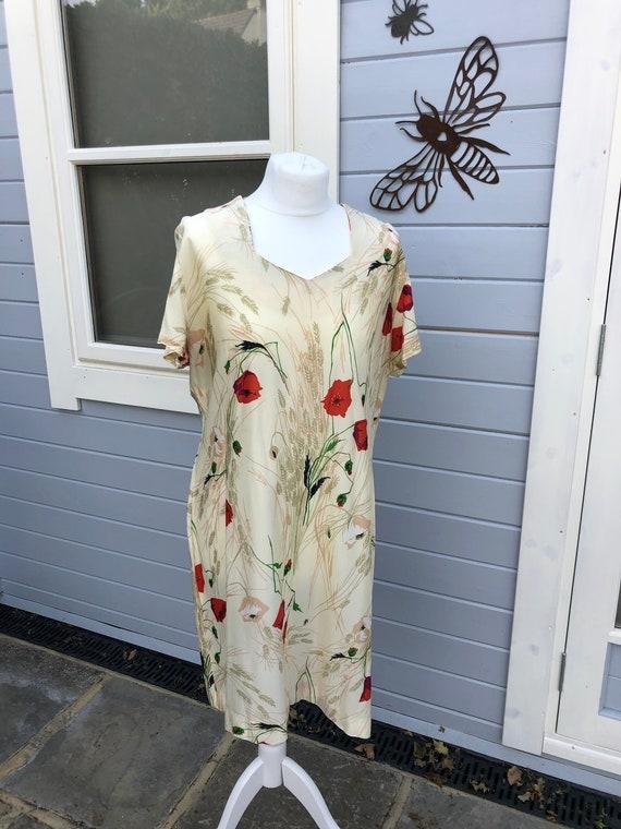 Vintage 1970's dress with a poppy pattern, vintage