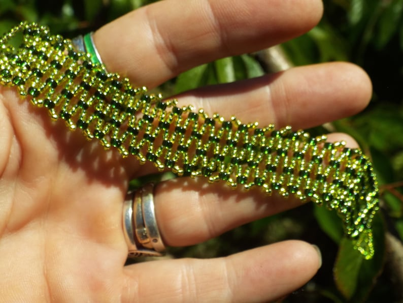Seed bead bracelet in greens With a ball and loop closure. Native tribal boho Green bracelet