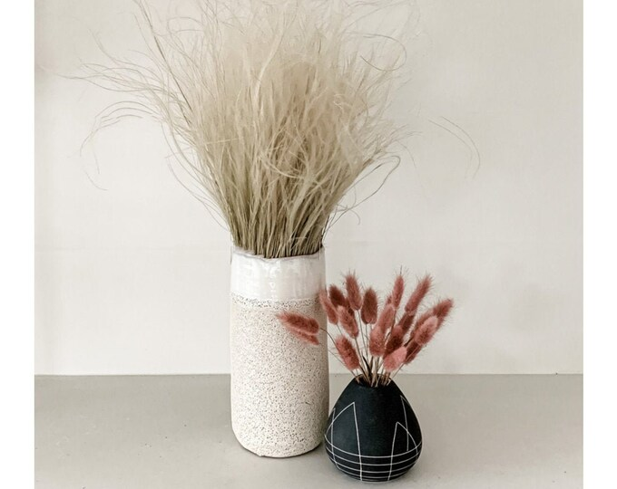 Set of Feather Grass Bundle in a Ceramic White Vase and Pink Bunny Tails in a Black Bud Vase