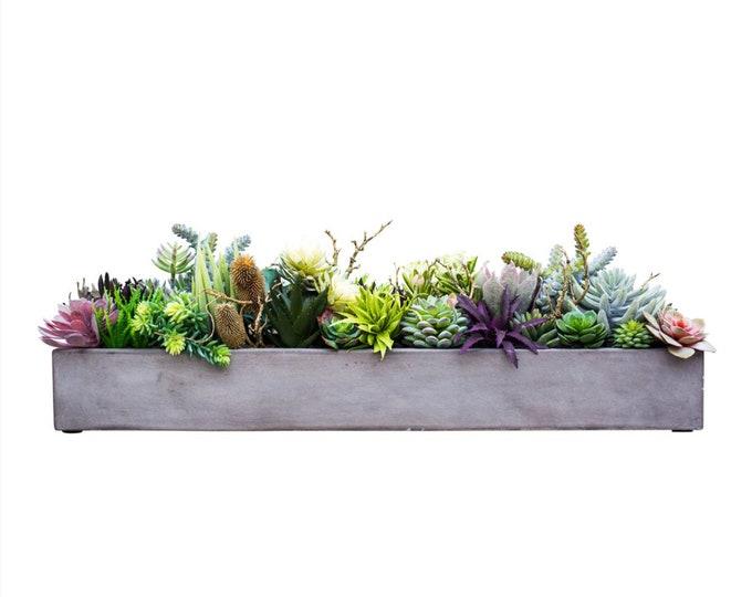 Faux Succulents in a Gray Concrete Trough