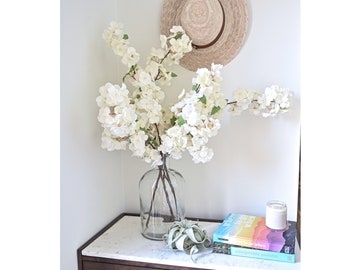 3 Fluffy Soft White Faux Artificial Pear Blossom Branches and a Clear Bottle Neck Vase