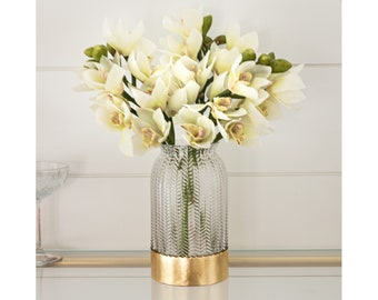 Faux, Artificial Creamy White Cymbidium Orchid Stems Anchored in a Decorative Gold Accented Glass Vase