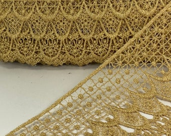 4.75 inch wide metallic venise lace rayon trim, sold by the yard.