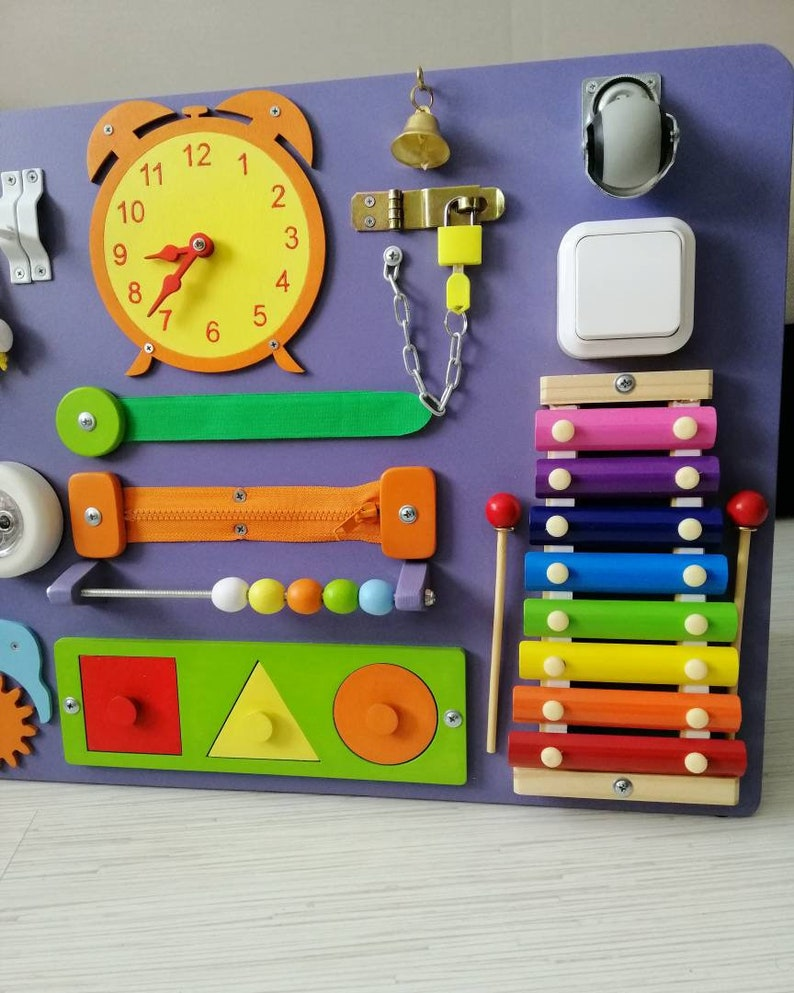 Toddler busy board with chalkboard Sensory board toddler ...