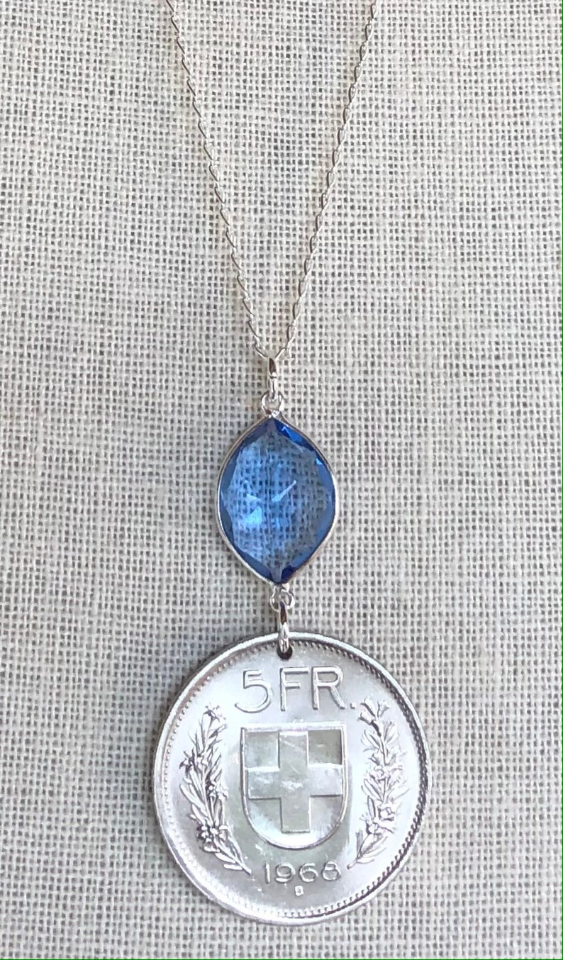 Swiss escutcheon with flower wreaths. Vintage 1968 Switzerland 5 Franc Coin with Tanzanite on 26\u201d Sterling Silver Necklace