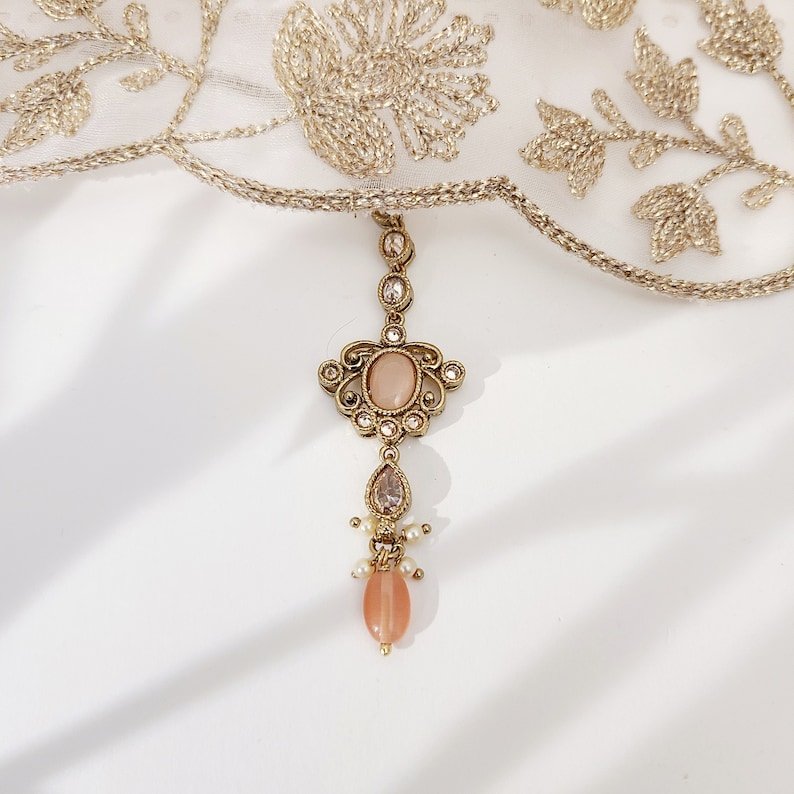 22k Gold plated IndianSouth Asian designed necklace set with gold zircon diamonds and peach accents Comes with matching earrings and tikka
