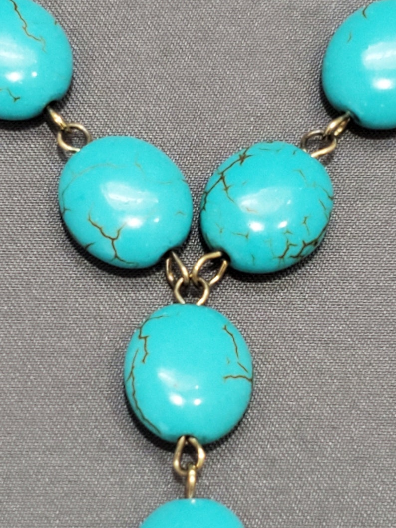 Turquoise Beaded Necklace with Bronze Amulet