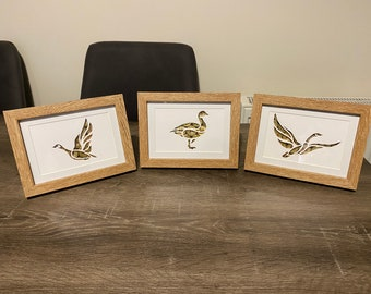 Framed Flying duck cutout with shotgun cartridge background