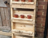 Vertical planter. Ideal for growing herbs veg in a small garden. Flipped upside down the pot holders become pots themselves