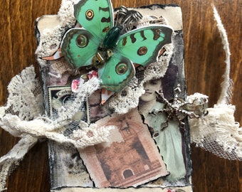 Altered playing card accordion book