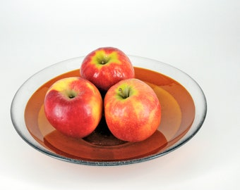 """Art Glass Bowl - footed fused - 11 1/2"""" diameter x 2 1/2"""" deep - made with medium amber solid transparent glass"""