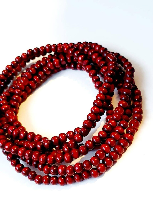 Lot of 100. Santawood beads 6mm