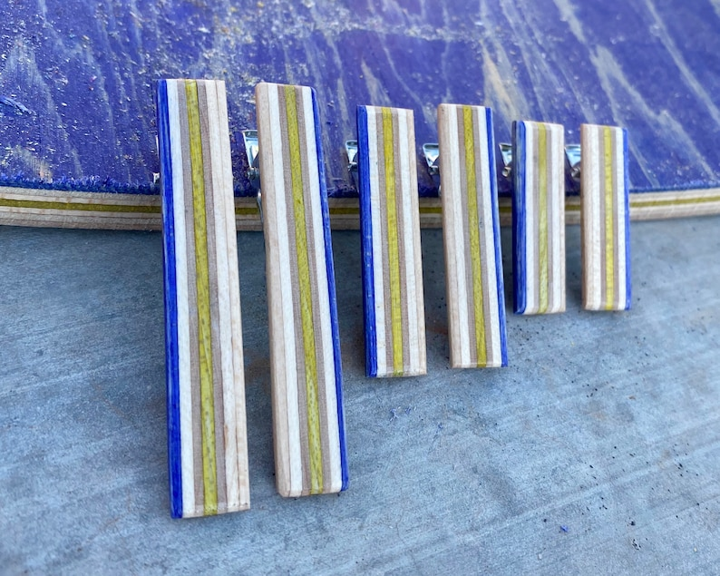 Blue and Yellow Alligator Hair Clips Made From Recycled Skateboard