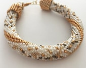 Crochet bracelet with gold, brown, creme and white with a shoe charm | HookedbyAdinda