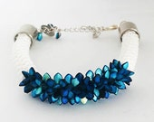 Crochet bracelet with blue spikes Gekko Beads and white beads with silver clasp | Hooked by Adinda