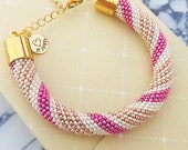 Crochet bracelet bangle in pink, gold and white with lobster claw closing | Hooked by Adinda