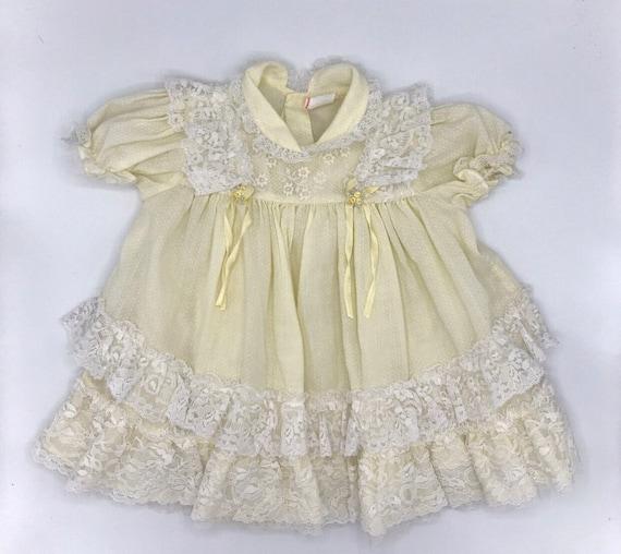 Vintage yellow smocked baby dress