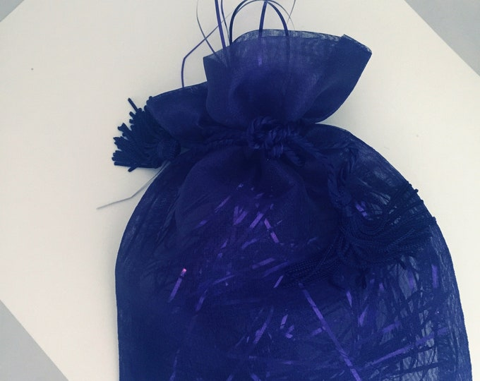Gift packaging in Purple jewelry bag wtih purple raffia