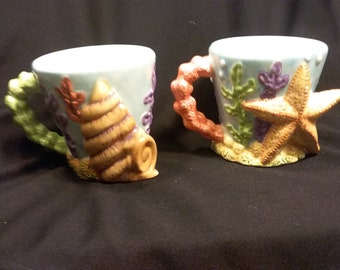 Two Sea Shell mugs