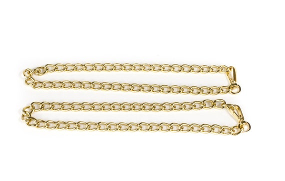 Chunky gold tone chain necklaces or belt