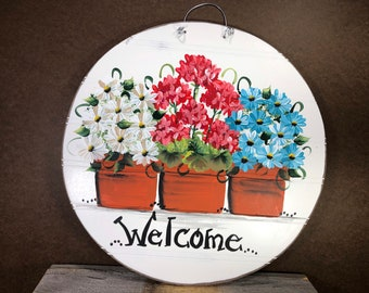 White and teal daisies and geraniums in flower pots painted on bead board.