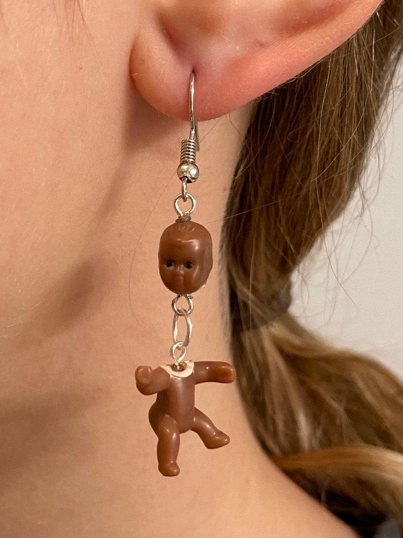 disembodied baby earrings