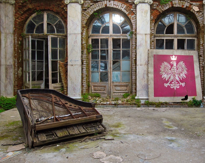 Featured listing image: Photo of an old piano and Polish emblem in an abandoned palace in Poland, URBEX