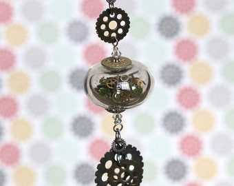 STEAMPUNK Lampwork glass pendants.  They are hollow and filled with Swarovski crystals  and recycled antique watch parts /chain included)