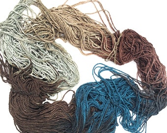 BEIJING #465 in the URBAN YARN line of multicolored rayon cord in teal, brown, beige and gray, for the workers and industry of busy China