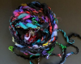 LICORICE & GUMDROPS- #102 in the CANDY line of specialty yarns.  Hand-dyed and hand-spun. About 50 percent black with assorted bright colors