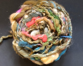 CHOCOLATE TRUFFLES - #131 CANDY line. Hand-dyed hand-spun wool yarn with mohair curls. About 75% browns and tans with coral, pink, and blues