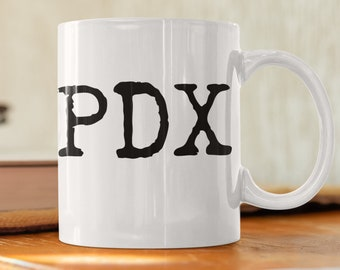 PDX coffee, tea and soup mug! Classic 11oz size and shape. For left-handed peeps.