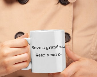Save a grandma. Wear a mask. White ceramic right-handed 11oz mug. (left-handed available!)
