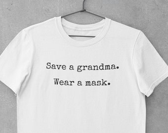 Save a grandma - wear a mask t shirt made with 100% Airlume cotton. A high quality, super soft yet strong crew neck tee. Love you, grandma!