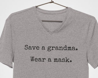 Save a grandma - wear a mask short-sleeved v-neck t-shirt. 100% Airlume cotton, preshrunk, jersey knit tee shirt.