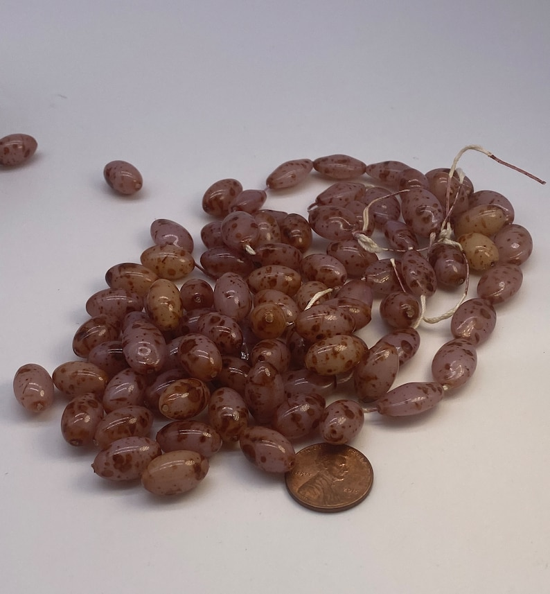 Vintage oval speckled beads. 26 pieces per price